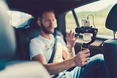 UGC video creator in back of car